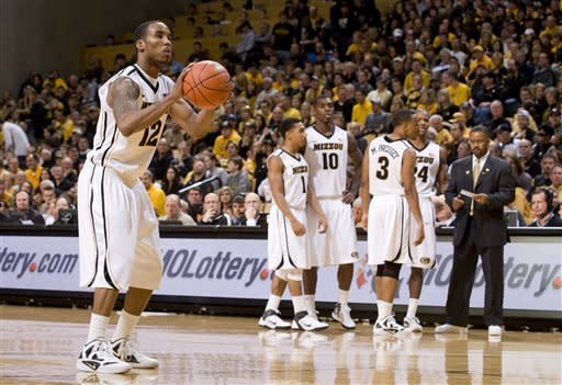 Missouri's Marcus Denmon, left, shoots free throws after a technical foul was called on the Texas Tech bench during the second half of an NCAA college basketball game Saturday, Jan. 28, 2012, in Columbia, Mo. Missouri won the game 63-50. (AP Photo/L.G. Patterson)