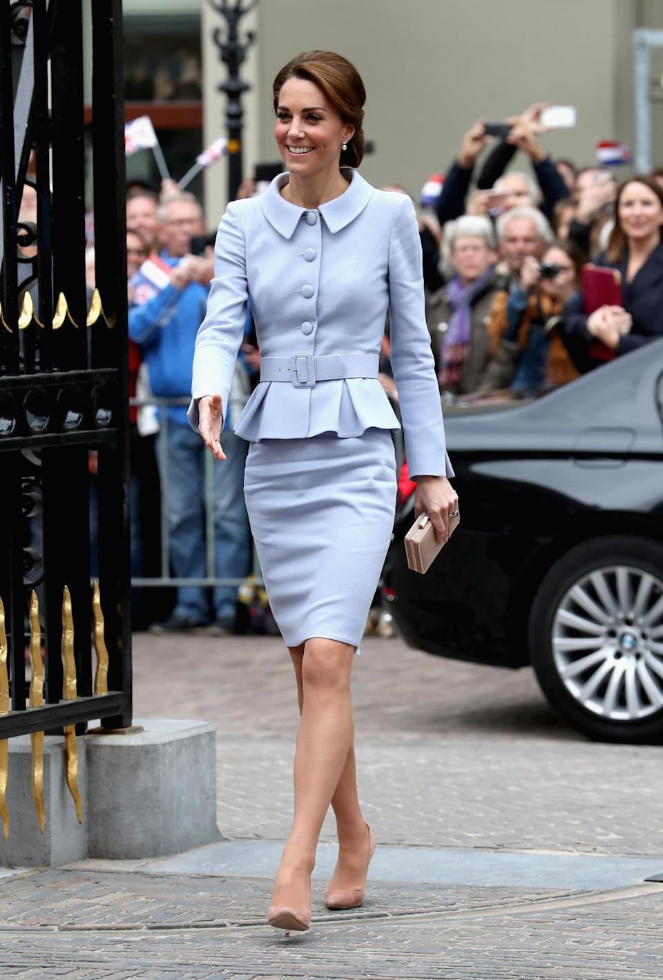 <p>The Duchess arrived in the Netherlands for her first solo foreign mission wearing a pale blue suit by Catherine Walker. She completed the look with nude heels and a clutch bag.</p><p><i>[Photo: Getty]</i></p>