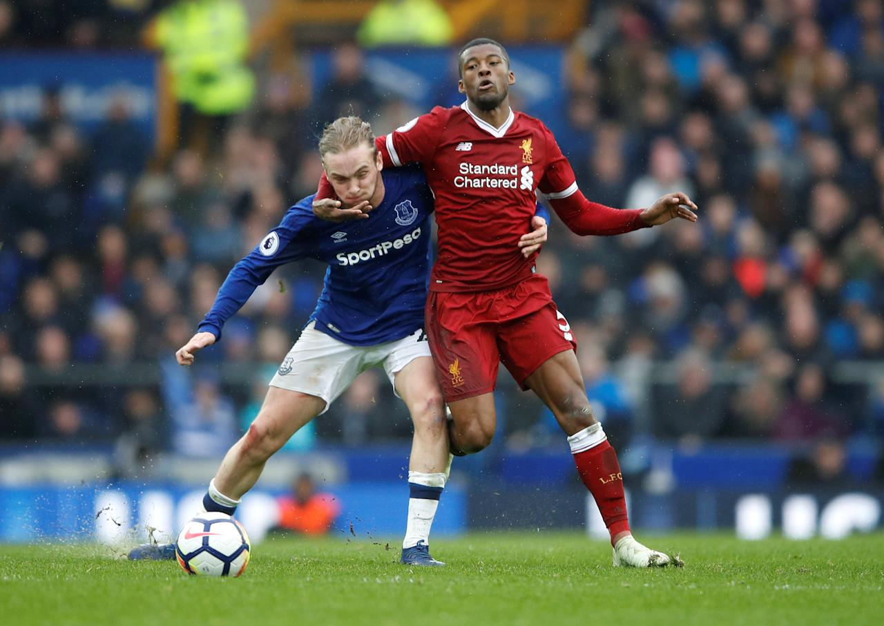 <p>Liverpool's Georginio Wijnaldum iwraps himself around Everton's Tom Davies </p>