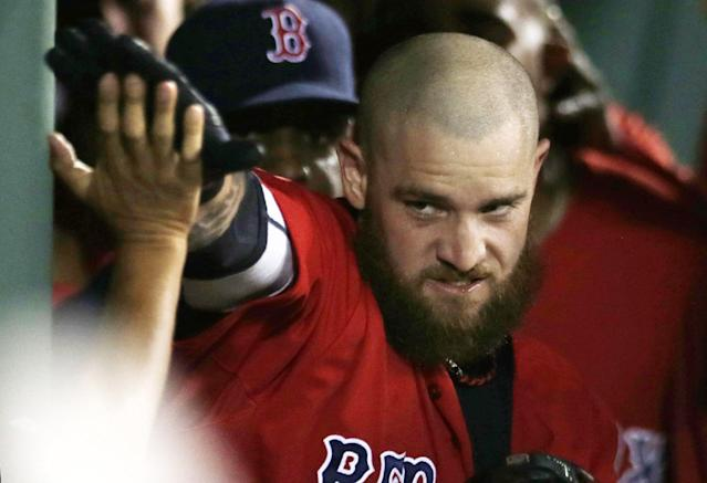 Boston Red Sox pinch-hitter Jonny Gomes is congratulated by teammates after his two-run home run against the Kansas City Royals during the sixth inning of a baseball game at Fenway Park in Boston, Friday, July 18, 2014. (AP Photo/Charles Krupa)
