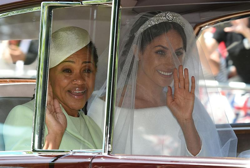 Meghan Markle (R) and her mother, Doria Ragland, arrive for her wedding ceremony to marry Britain's Prince Harry, Duke of Sussex, at St George's Chapel, Windsor Castle, in Windsor, on May 19, 2018)