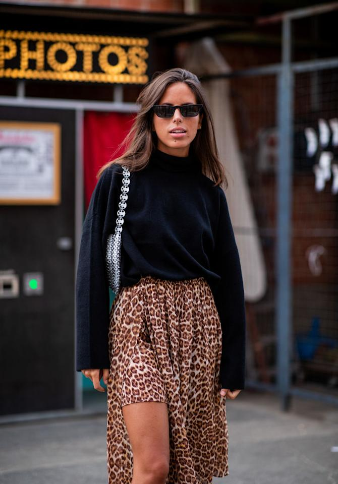 <p>Nina Urgell Cloquell wears a leopard print-skirt and black sweater at Arena Berlin on Aug. 31, 2018, in Berlin. (Photo: Christian Vierig/Getty Images for Zalando) </p>