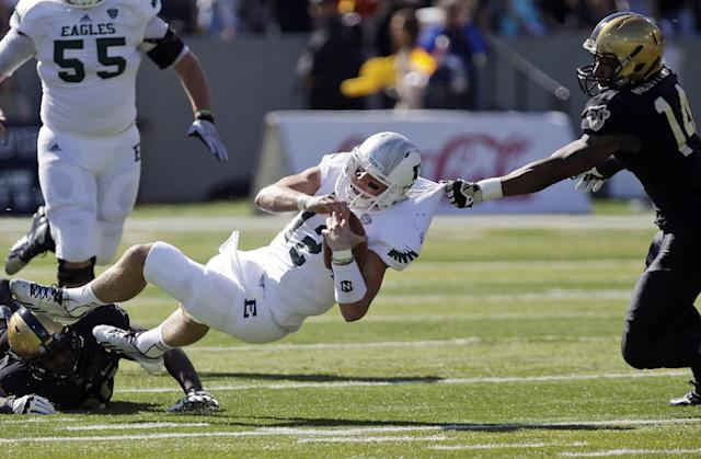 Eastern Michigan quarterback Tyler Benz (12) is tackled by Army defensive back Chris Carnegie (14) during the first half of an NCAA college football game on Saturday, Oct. 12, 2013, in West Point, N.Y. (AP Photo/Mike Groll)