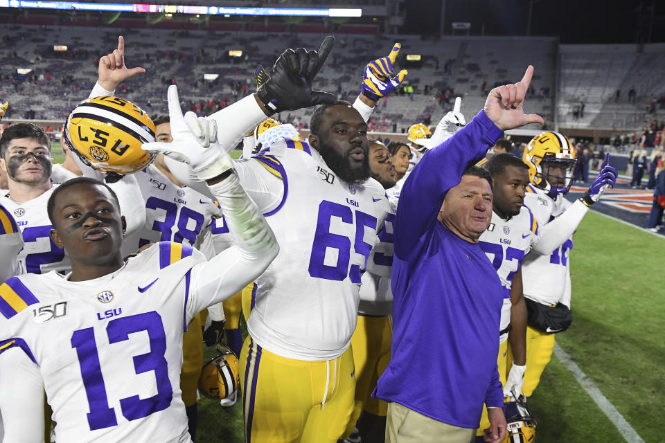 LSU head coach Ed Orgeron and players celebrate after an NCAA college football game against Mississippi in Oxford, Miss., Saturday, Nov. 16, 2019. No. 1 LSU won 58-37. (AP Photo/Thomas Graning)