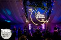 """<p>One of Parker's favorite memories of the night was the light-up moon that was lowered from the ceiling as a surprise for the newlyweds as Ronnie Dunn sang """"Neon Moon.""""</p>"""