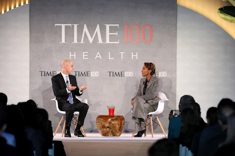 Commissioner of the NBA, Adam Silver (L), speaks with news broadcaster, Robin Roberts, onstage during the TIME 100 Health Summit at Pier 17 in New York City on Oct. 17, 2019. | Cindy Ord—Getty Images for TIME 100 Health