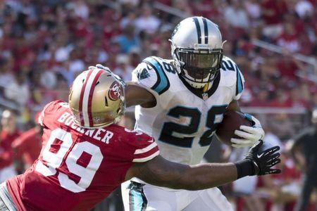 FILE PHOTO: September 10, 2017; Santa Clara, CA, USA; Carolina Panthers running back Jonathan Stewart (28) runs with the football against San Francisco 49ers defensive end DeForest Buckner (99) during the third quarter at Levi's Stadium. The Panthers defeated the 49ers 23-3. Mandatory Credit: Kyle Terada-USA TODAY Sports