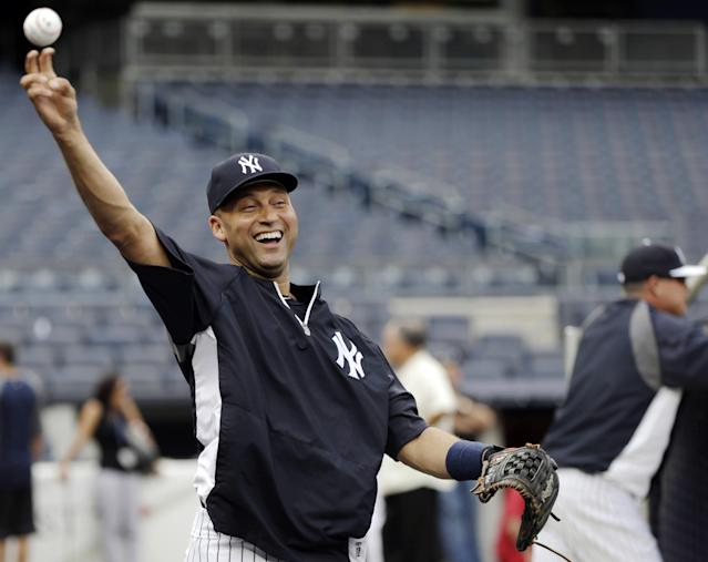 FILE - In this Aug. 13, 2013, file photo, New York Yankees shortstop Derek Jeter throws on the field before a baseball game against the Los Angeles Angels in New York. Jeter and the Yankees have agreed to a $12 million, one-year contract on Friday, Nov. 1, 2013. (AP Photo/Kathy Willens, File)