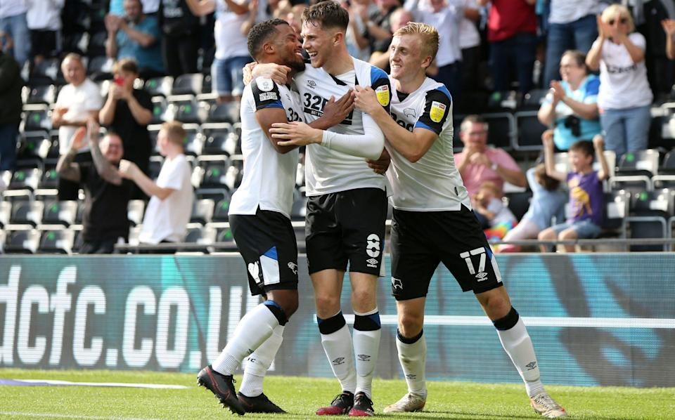 Derby County's Max Bird (centre) celebrates with Nathan Byrne (left) and Louie Sibley after scoring their side's first goal of their win over Stoke - PA