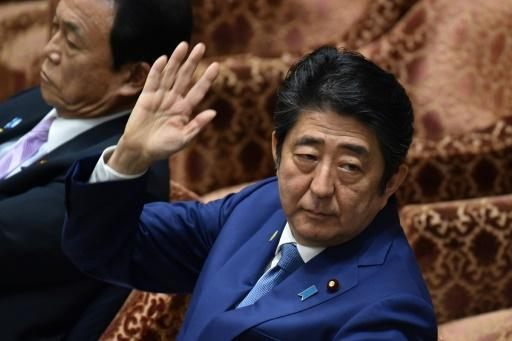 Japanese nationalist claims cash from Abe as scandal deepens