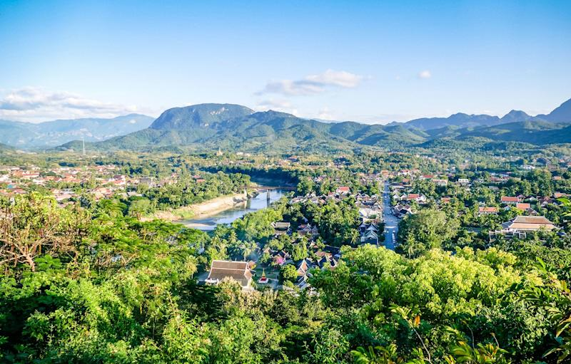 Luang Prang's skyline is lined with palm trees - Craig Hastings