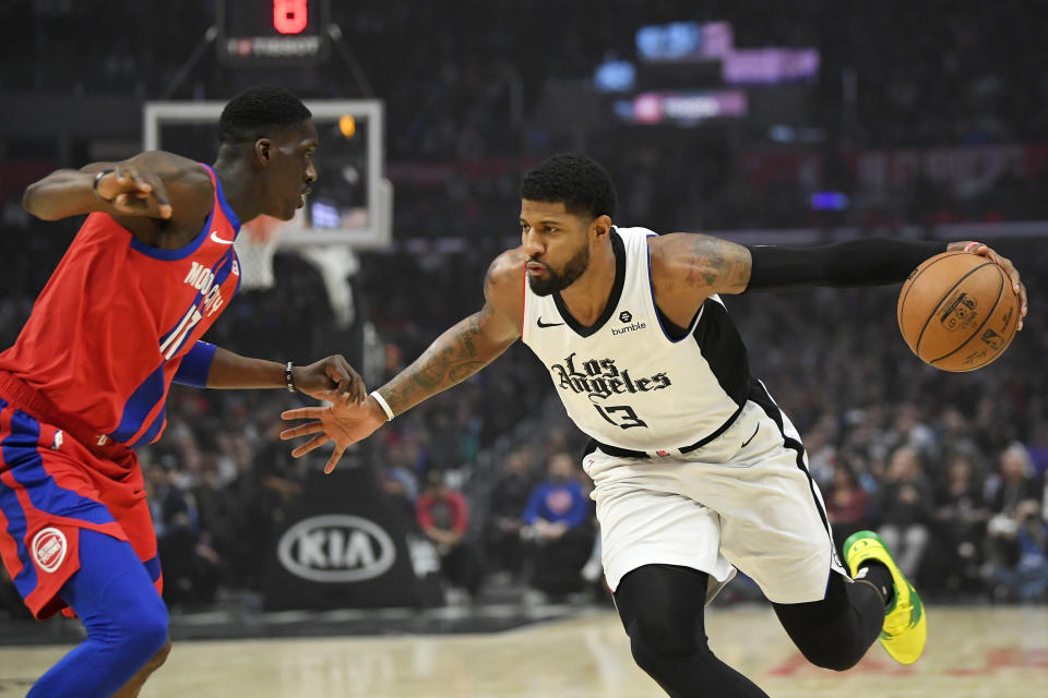 Los Angeles Clippers forward Paul George, right, tries to drive past Detroit Pistons guard Tony Snell during the first half of an NBA basketball game Thursday, Jan. 2, 2020, in Los Angeles. (AP Photo/Mark J. Terrill)