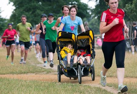 FILE PHOTO: Participants take part in a parkrun event at Bushy Park in London August 2, 2014. REUTERS/Neil Hall/File Photo