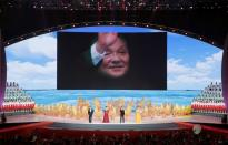 A picture of late Chinese leader Deng Xiaoping is seen on a giant screen during a cultural performance in Macau