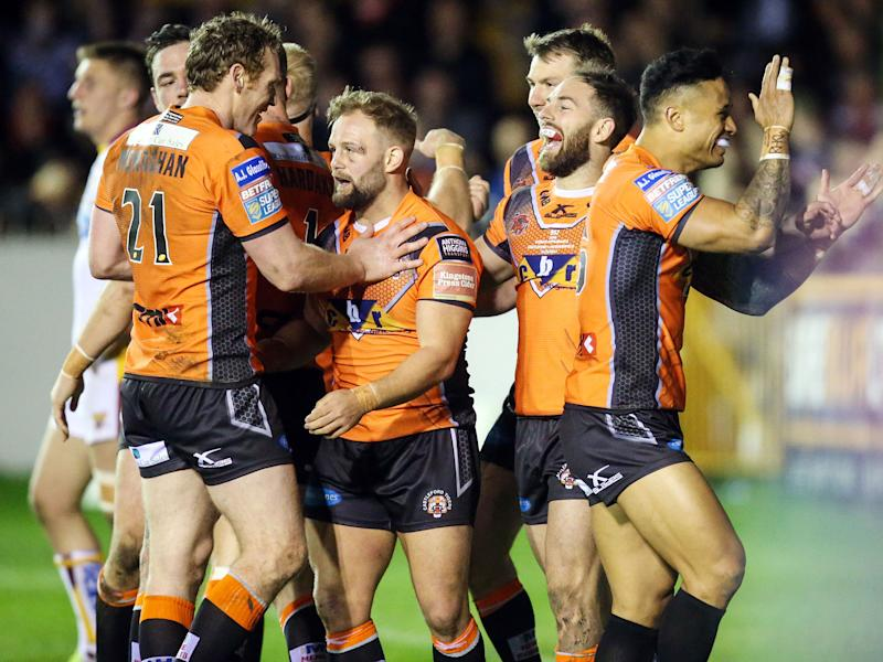 Luke Gale (2nd right) celebrates scoring for Castleford against Huddersfield Giants: PA
