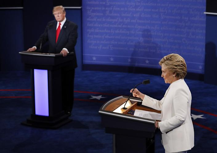 Hillary Clinton speaks as Donald Trump looks on during the third presidential debate in Las Vegas, Oct. 19, 2016. (Photo: Mark Ralston/Pool via AP)