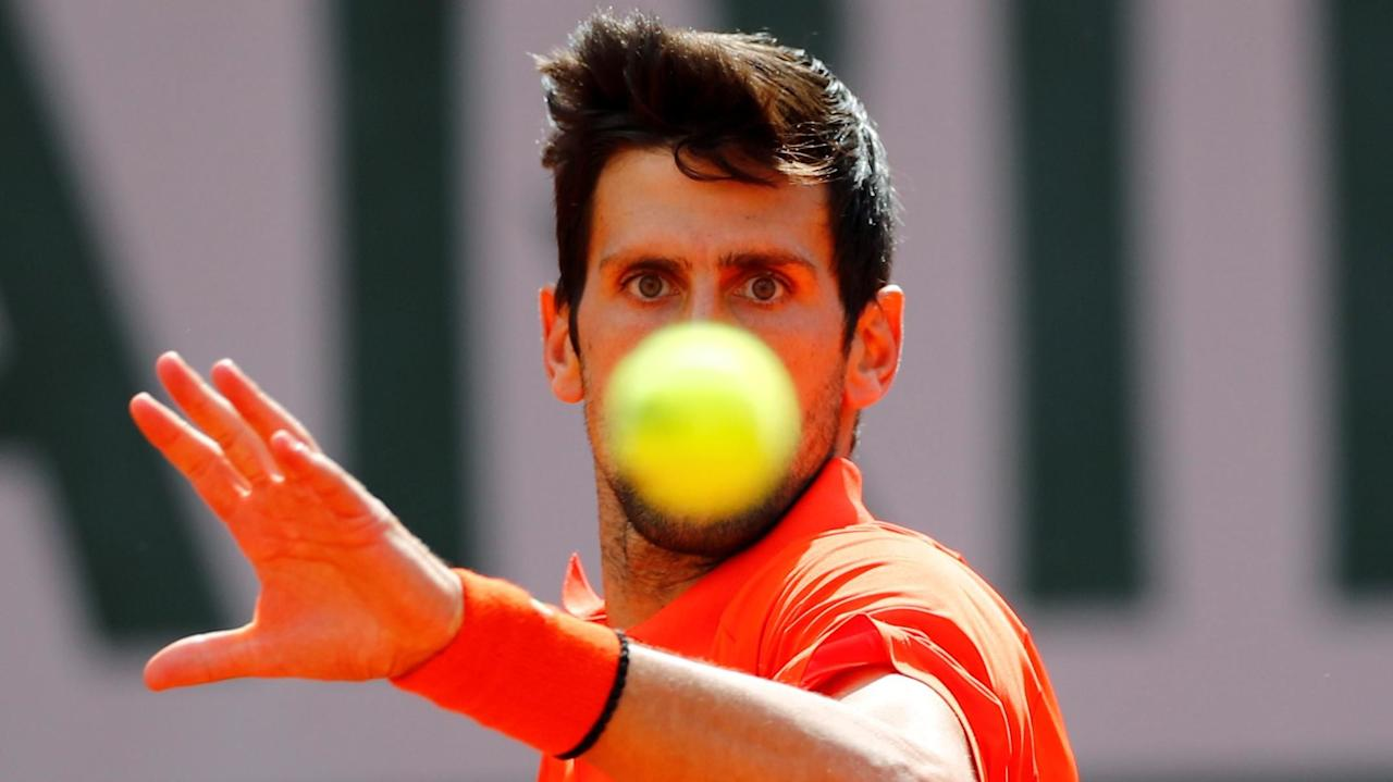 Kai Pfaffenbach / Reuters - Tennis - French Open - Roland Garros, Paris, France - May 27, 2019. Serbia's Novak Djokovic in action during his first round match against Poland's Hubert Hurkacz. REUTERS/Kai Pfaffenbach     TPX IMAGES OF THE DAY