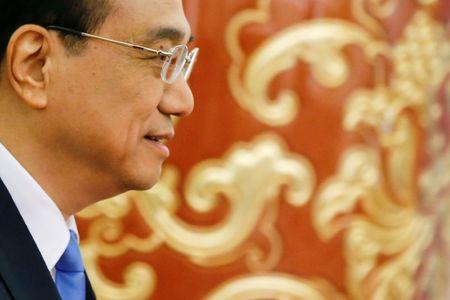 FILE PHOTO:  China's Premier Li Keqiang arrives for a news conference after the closing ceremony of China's National People's Congress (NPC) at the Great Hall of the People in Beijing