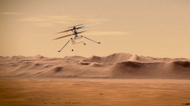 PHOTO: An artist's concept of NASA's Ingenuity Mars Helicopter flying through the Red Planet's skies. (NASA)