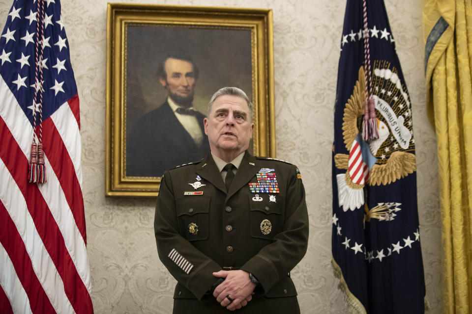 FILE - In this May 15, 2020 file photo, Joint Chiefs Chairman Gen. Mark Milley speaks during the presentation of the Space Force Flag in the Oval Office of the White House with President Donald Trump, in Washington. The top U.S. general held unannounced talks with Taliban peace negotiators in the Persian Gulf to urge a reduction in violence across Afghanistan, even as senior American officials in Kabul warned that stepped-up Taliban attacks endanger the militant group's nascent peace negotiations with the Afghan government. (AP Photo/Alex Brandon, File)