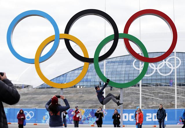 Team USA speed skater Aly Dudek of Hales Corner's, Wis., hangs from the Olympic rings while posing for a teammate at Olympic Park ahead of the 2014 Winter Olympics, Wednesday, Feb. 5, 2014, in Sochi, Russia. (AP Photo/Robert F. Bukaty)