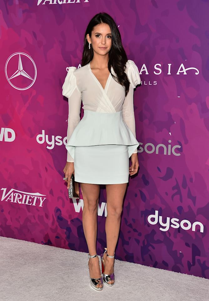 <p>Dobrev made a statement in a white silk long-sleeved crossover top and an aqua green peplum mini skirt. Her metallic heels completed the look. <em>(Photo: Getty Images)</em> </p>