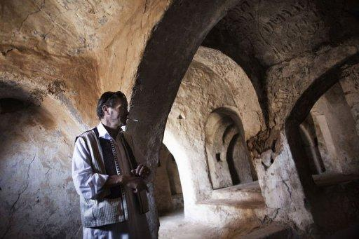 Libyan Omar Aboud, from the ancient Amazigh (Berber) tribe, stands inside one of the surviving synagogues in the Berber village of Yafran in western Libya on July 13. For centuries, Jews lived among the Berbers of Yafran, observing the Sabbath at the synagogue of Ghriba, but they suddenly left 63 years ago, and their land in Libya remains untouched