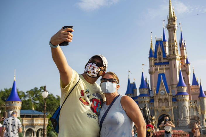 Guests in face masks at the reopened Walt Disney World Resort in Florida - the state reported 15,000 new COVID-19 cases on Sunday (Getty Images)
