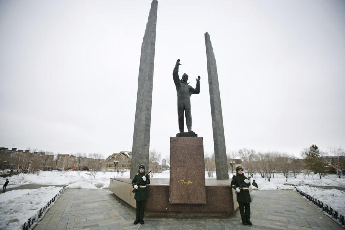 Honor guards stand at the monument of Yuri Gagarin, the first person who flew to space, in Orenburg, Russia, Saturday, March 9, 2019. Yuri Gagarin studied at the Chkalovsk Military Aviation School of Pilots from 1955 to 1957. From a giant statue towering over Moscow to a more modest monument on the Sakhalin Island in the Pacific Ocean, dozens of memorials across Russia commemorate Yuri Gagarin, the cosmonaut who became the first person in space on April 12, 1961, 60 years ago. (AP Photo/Sergey Medvedev)