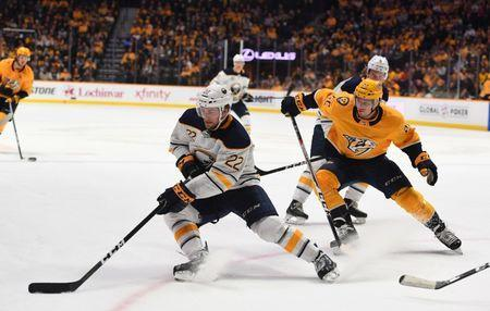 Dec 3, 2018; Nashville, TN, USA; Buffalo Sabres center Johan Larsson (22) handles the puck away from Nashville Predators left wing Kevin Fiala (22) during the second period at Bridgestone Arena. Mandatory Credit: Christopher Hanewinckel-USA TODAY Sports