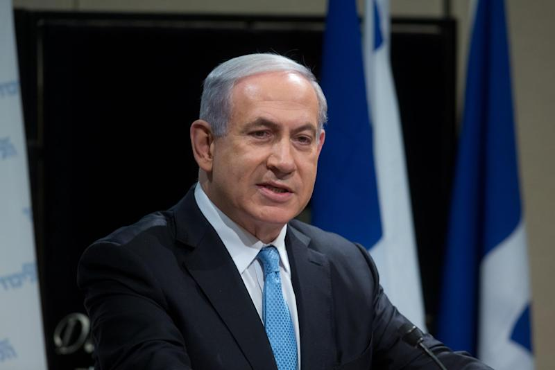 Israeli Prime Minister Benjamin Netanyahu talks during a Likud party election campaign meeting in Tel Aviv on January 25, 2015 ahead of the March 17 general elections
