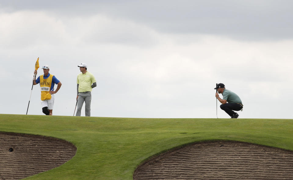 United States' Brian Harman lines up his putt on the 10th green during the first round British Open Golf Championship at Royal St George's golf course Sandwich, England, Thursday, July 15, 2021. (AP Photo/Peter Morrison)