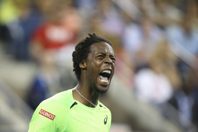 Gael Monfils, of France, reacts during a match against Roger Federer, of Switzerland, during the quarterfinals of the U.S. Open tennis tournament, Thursday, Sept. 4, 2014, in New York. (AP Photo/John Minchillo)