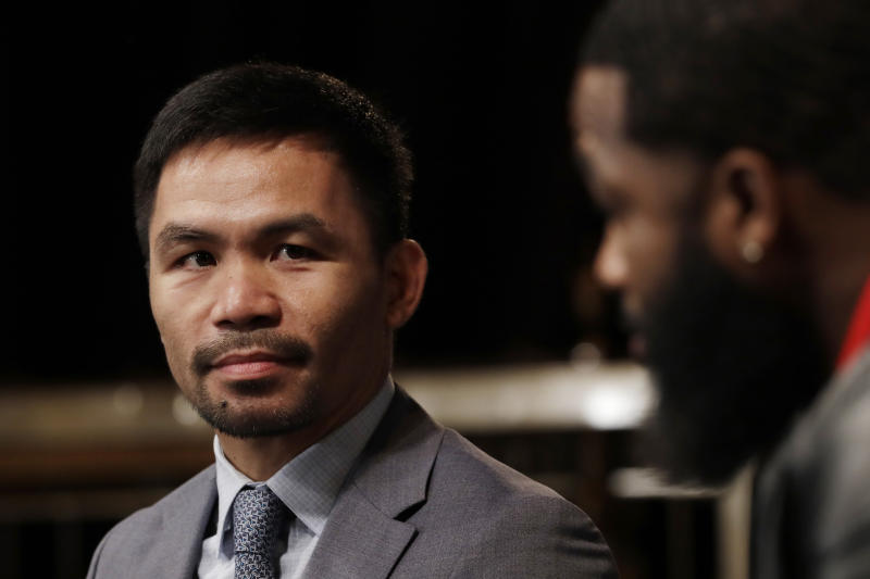 CORRECTS SPELLING TO PACQUIAO, NOT PAQUIAO AS ORIGINALLY SENT - Manny Pacquiao, left, and Adrien Broner attend a news conference, Monday, Nov. 19, 2018, in New York. Pacquiao will defend his World Boxing Association welterweight title against Broner on Jan. 19, 2019, in Las Vegas. (AP Photo/Mark Lennihan)
