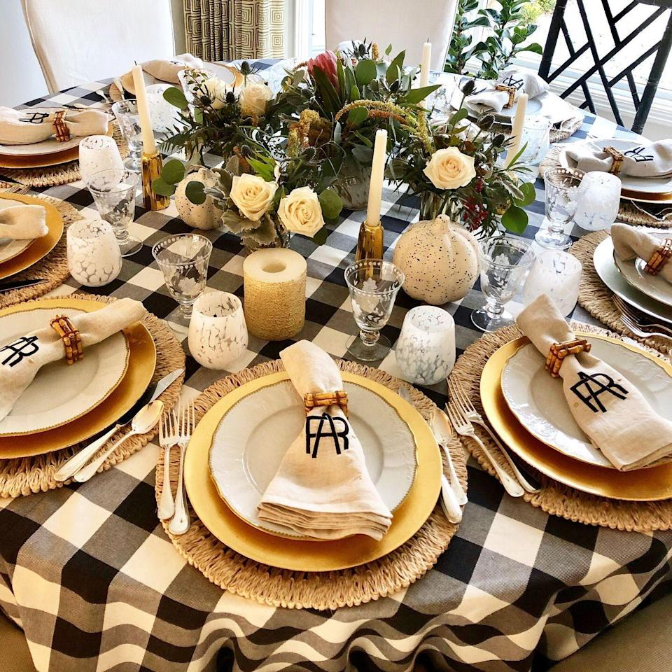 "<p>To balance a graphic checkered tablecloth, designer <a href=""http://www.reynalinteriors.com/"" rel=""nofollow noopener"" target=""_blank"" data-ylk=""slk:Amanda Reynal"" class=""link rapid-noclick-resp"">Amanda Reynal</a> used a simple arrangement of white roses surrounded by lush greenery. White candlesticks in brass holders add to the look. </p><p><em><a href=""http://www.reynalinteriors.com/"" rel=""nofollow noopener"" target=""_blank"" data-ylk=""slk:Via Amanda Reynal"" class=""link rapid-noclick-resp"">Via Amanda Reynal</a> </em></p>"