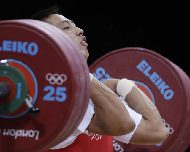 North Korea's Kim Myong Hyok competes during the men's 69-kg weightlifting competition at the 2012 Summer Olympics, Tuesday, July 31, 2012, in London. (AP Photo/Mike Groll)