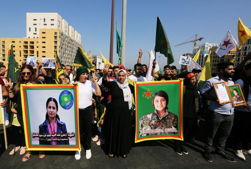 Kurds living in Lebanon hold Hevrin Khalaf's picture, a Kurdish politician who was killed in Syria, during a protest against Turkey's military action in northeastern Syria, in Beirut