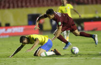 Brazil's Pedro, left, and Venezuela's Yordan Osorio battle for the ball during a qualifying soccer match for the FIFA World Cup Qatar 2022 in Sao Paulo, Brazil, Friday, Nov.13, 2020. (AP Photo/Andre Penner, Pool)