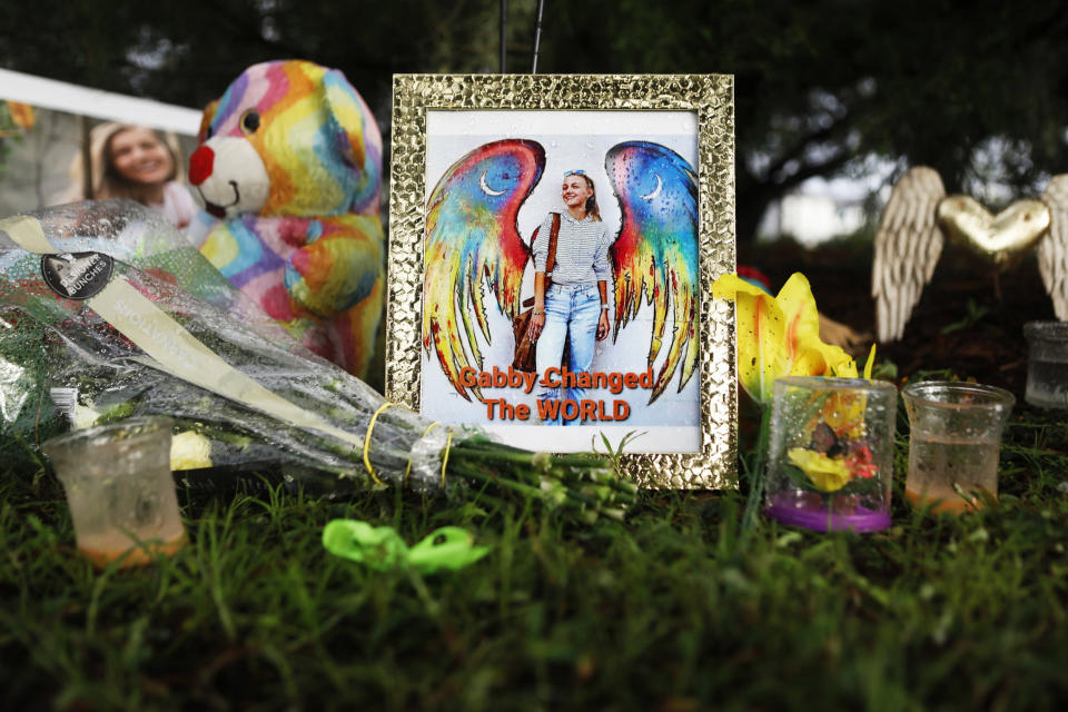 Flowers and photographs adorn a makeshift memorial dedicated for Gabby Petito in North Port, Fla., on Sept. 21, 2021. (Octavio Jones / Getty Images)