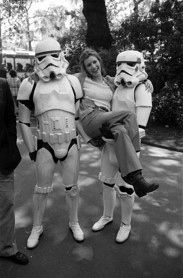 The stars of 'Star Wars: Episode V û The Empire Strikes Back' attend a photocall outside the Savoy Hotel, actress Carrie Fisher with the Stormtroopers, 19th May 1980. (Photo by Alisdair MacDonald/Daily Mirror/Mirrorpix/Getty Images)