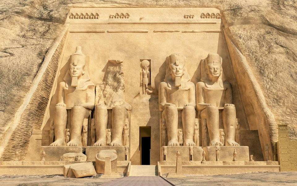 <p>Pharaoh Ramesses II commissioned the two massive rock temples at Abu Simbel as a way to showcase his divine nature and pay respects to gods Ra-Horakty and Ptah, goddess Hathor, and his wife, Queen Nefertari. The four colossal figures seated at the entrance of this sandstone structure represent Ramesses with an etched image of Re-Horakhty above the doorway. Some scholars believe the temples date back to 1264 BCE after the pharaoh's victory at the Battle Kadesh, while others believe it came about later in 1244 BCE after the Nubian Campaigns of Ramesses and his sons. In the 1960s, the temples had to be moved and rebuilt onto a higher point atop the cliff after fears that the newly built Aswan High Dam on the Nile would submerge the sacred sites underwater. </p>