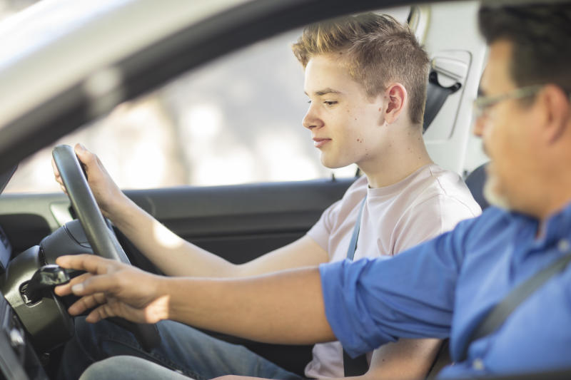 Picture of a young teenager driving with an instructor. Despite having to drive while supervised, learner drivers also have some 'risky driving' behaviours.