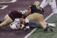 Coastal Carolina's Baden Pinson (31) falls into the end zone for a touchdown against Texas State's Emmanuel Galvan-Vazquez (97) and Brendon Luper (25) during the second half of an NCAA college football game in San Marcos, Texas, Saturday, Nov. 28, 2020. (AP Photo/Chuck Burton)