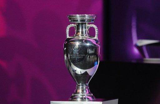 The European trophy stands on a plinth at the draw for the Euro 2012 championships in Kiev