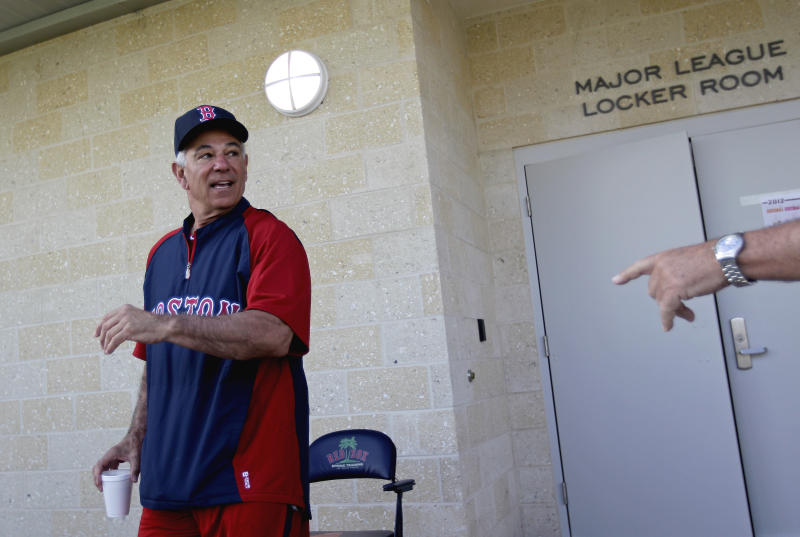 Boston Red Sox manager Bobby Valentine comes out from the clubhouse for a news conference as pitchers and catchers officially report to baseball spring training on Sunday, Feb. 19, 2012, in Fort Myers, Fla. (AP Photo/David Goldman)