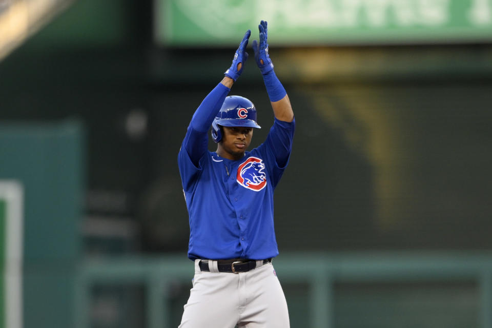 Chicago Cubs' Sergio Alcantara gestures at second after his double during the third inning of the team's baseball game against the Washington Nationals, Friday, July 30, 2021, in Washington. (AP Photo/Nick Wass)