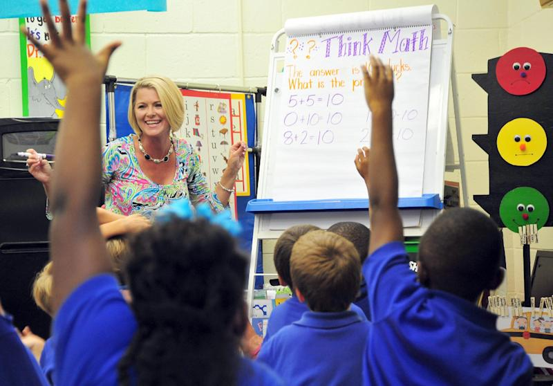 Teacher Deanna Jump quizzes her first-grade students at Central Fellowship Christian Academy in Macon, Ga., on Wednesday, Sept. 12, 1012. Jump is the first million-dollar seller on teacherspayteachers.com, a website that teachers use to buy and sell school supplies, bulletin board designs and lesson plans. (AP Photo/Todd Stone)