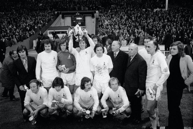 Tottenham celebrate with the League Cup after their 1-0 win over Norwich
