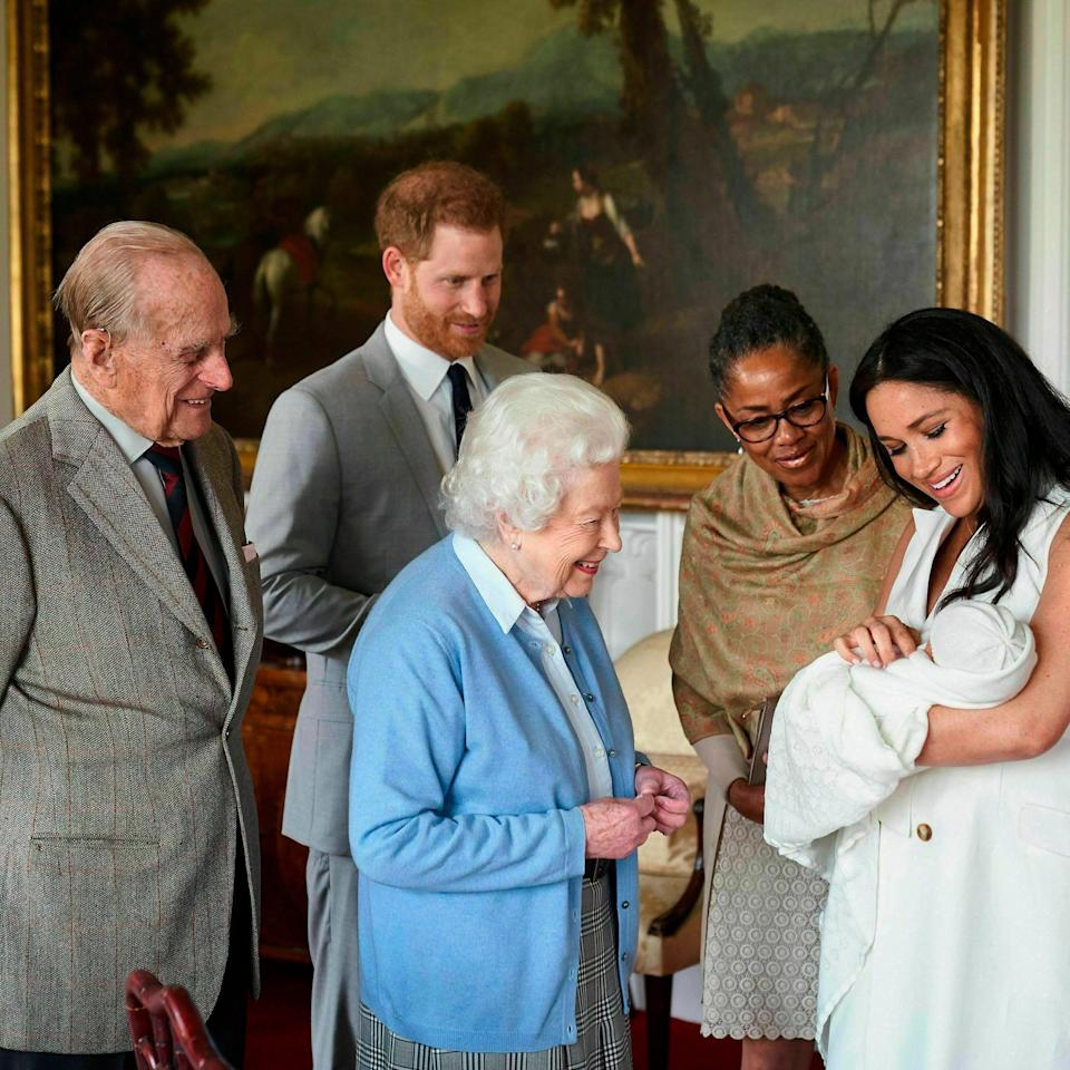 Prince Harry and Duchess Meghan, joined by her mother, Doria Ragland, show their new son to Queen Elizabeth II and Prince Philip at Windsor Castle, May 8, 2019.