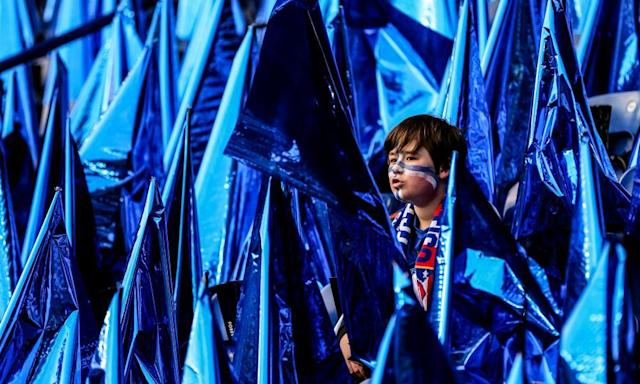 """<span class=""""element-image__caption"""">A Leicester City fan sits among the souvenir flags during the Champions League quarter-final against Atlético Madrid.</span> <span class=""""element-image__credit"""">Photograph: Catherine Ivill - AMA/Getty Images</span>"""
